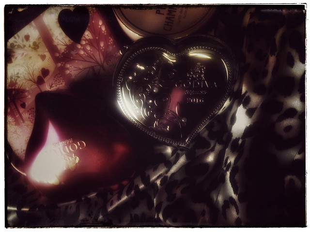 heart shaped Godiva tins in silver and pink