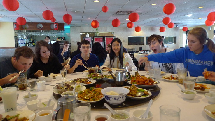 Students in the Chinese foreign language academy enjoying authentic Chinese food.
