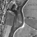 This 1946 aerial view shows the extent of the castle's outer bailey bordered by Castle Street. Below the castle, the two fields were once the small deer park that adjoined the castle. © Cheshire Archaeology Service, Chester