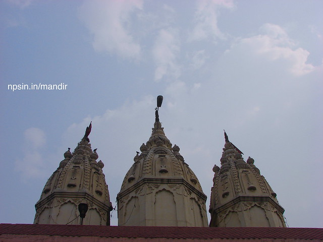 Height of temple towards sky shows, to devotees, ambition should be achieved with all efforts towards fulfillment.
