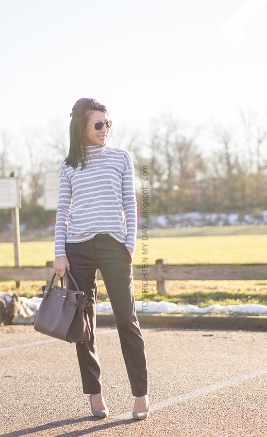 gray striped turtleneck, gray wool trousers, gray suede pumps