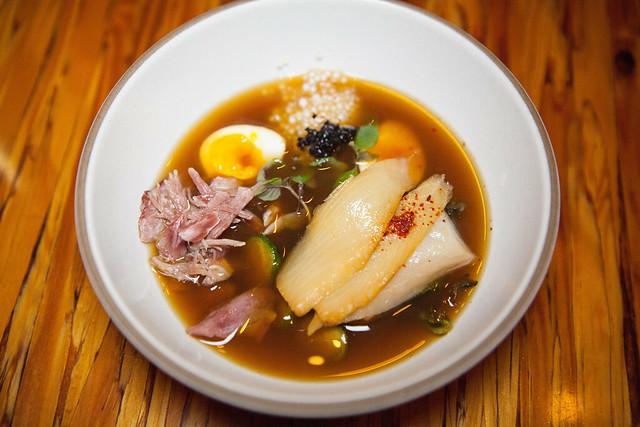 Duo De Porc Et Morue - Smoked Sablefish, Pork Hock, Brussels Sprouts, Quail Eggs, Porcini Mushroom Consommé