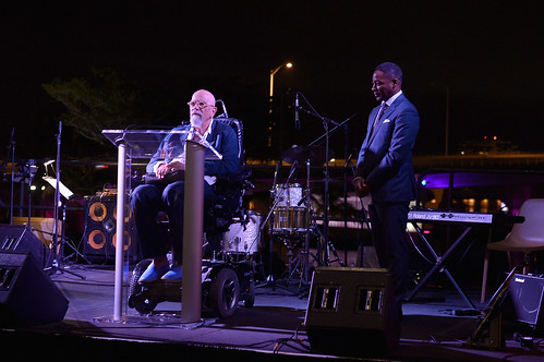 Chuck Close on stage with Franklin Sirmans at PAMM Art of the Party