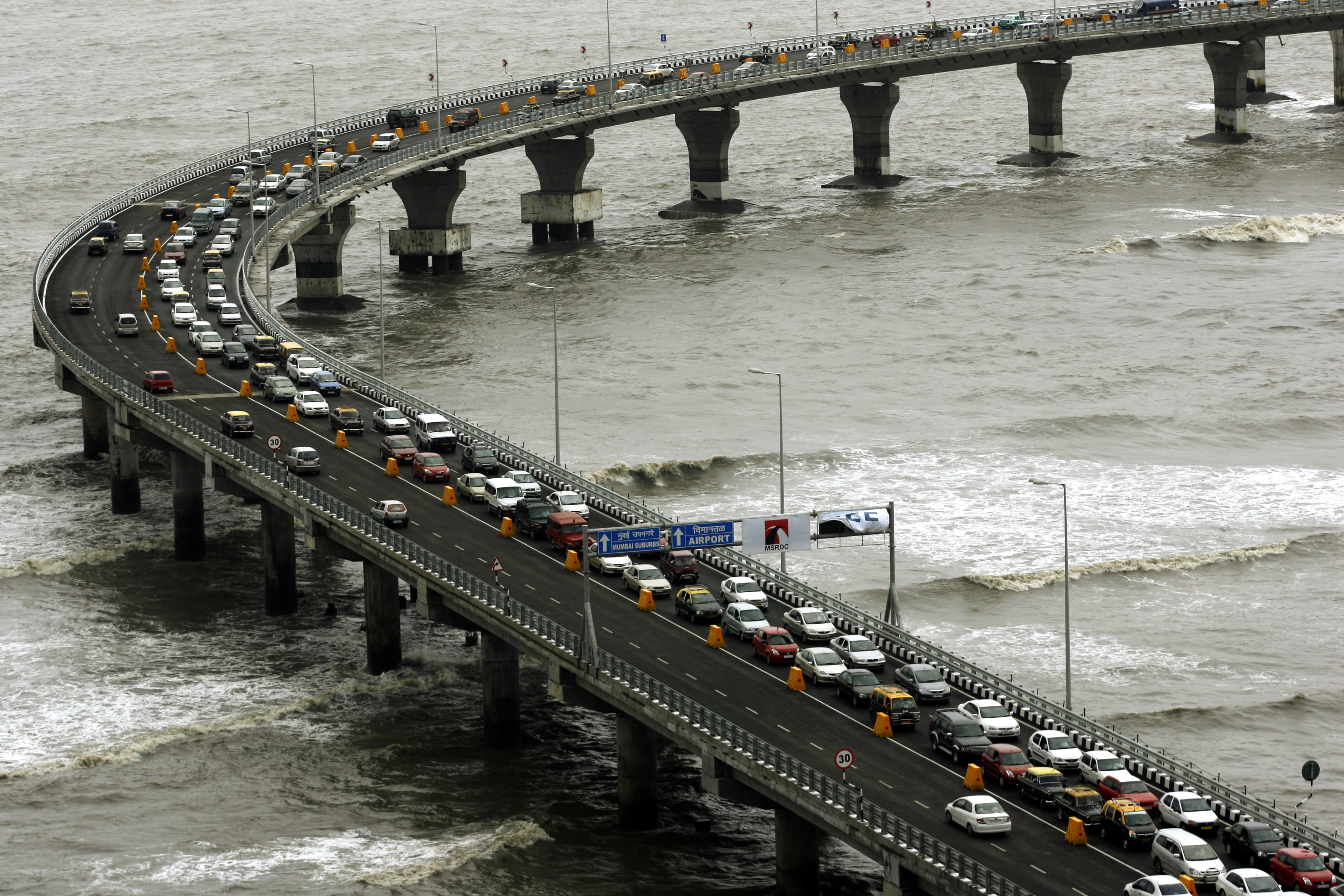 Bandra Worli Sealink was initially estimated to cost Rs 300 crore and move 1,00,000 cars a day. It ended up costing Rs 1,600 crore and its average daily ridership stands at 32,312 cars. Photo credit: Reuters
