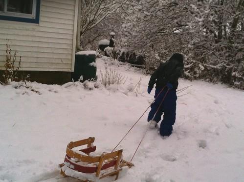 Boy pulling a sled