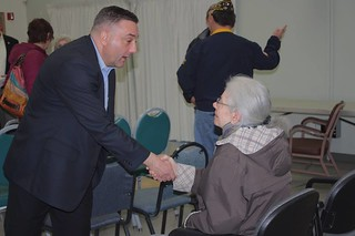 Rep. Jay Rodne meets with a constituent during a town hall in North Bend.