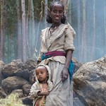 """Investing in Women: A Traveler's Perspective is up on the blog (link in profile). The article is my $0.02 on the meaning and imperative behind and beyond International Women's Day.  The image is one I took of a mother and daughter outside of Lalibela, E"