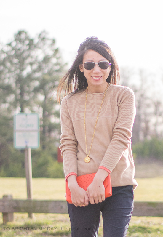 camel sweater tunic, gold jewelry, orange clutch, navy pants