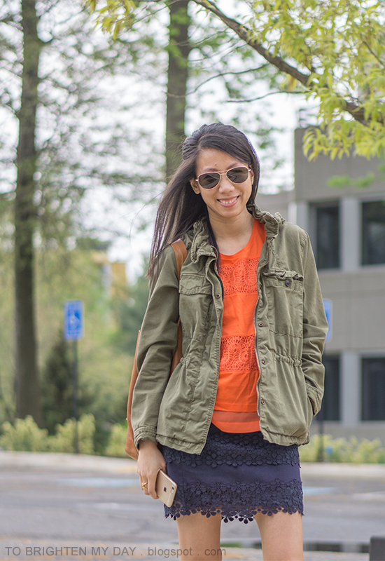 green military jacket, orange lace tank top, lace navy mini skirt, cognac brown tote