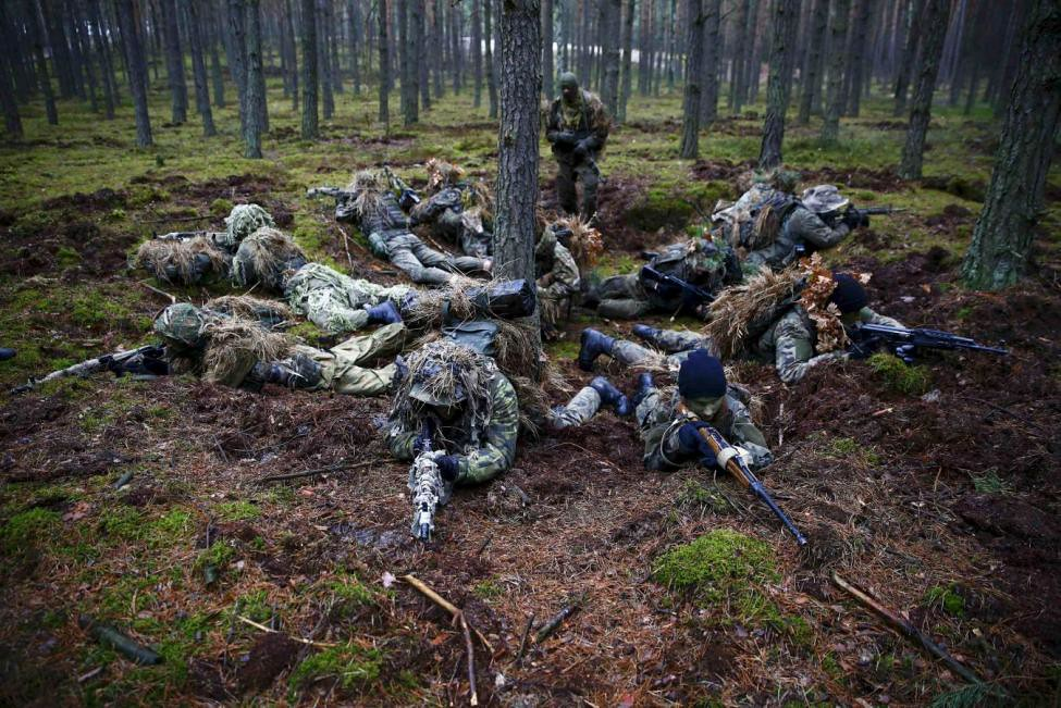 Participiants secure a position during a territorial defence training organised by paramilitary group SJS Strzelec (Shooters Association) in the forest near Minsk Mazowiecki