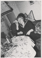 Woman playing with a toy musical instrument