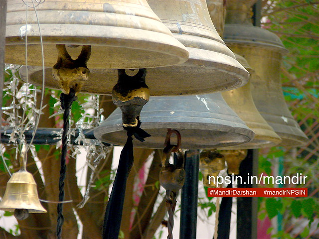 A no of heavy weight bells hanging in front of Shri Navgrah Dham temple, also called Shri Shani Dev Temple Lakhanpur. Most of the time children having craze to ringing them.