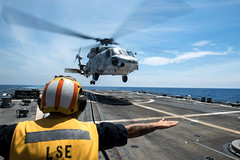 A Japan Maritime Self-Defense Force helicopter assigned to helicopter destroyer JS Ise (DDH 182) lands on USS Stockdale, April 17. (U.S. Navy/MC2 Andrew P. Holmes)