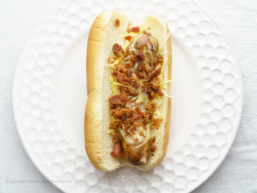 Chicken Hot Dog with shredded cheese and bacon bits