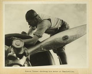 Roscoe Turner checking his plane engine at Charleville 1934