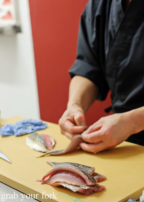 Peeling the skin off shima aji yellowtail sashimi at Sashimi Shinsengumi, Crows Nest