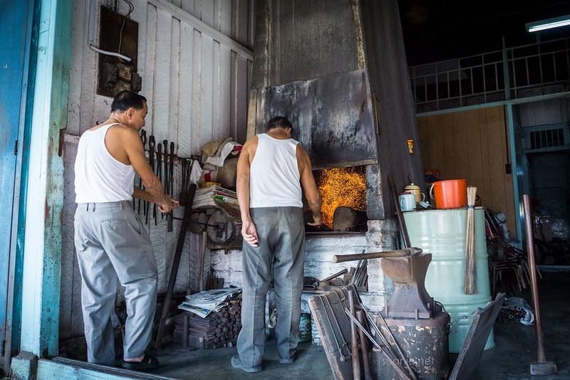 Blacksmith Sri Gading - making the fire