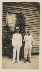 Two men standing in front of a wall