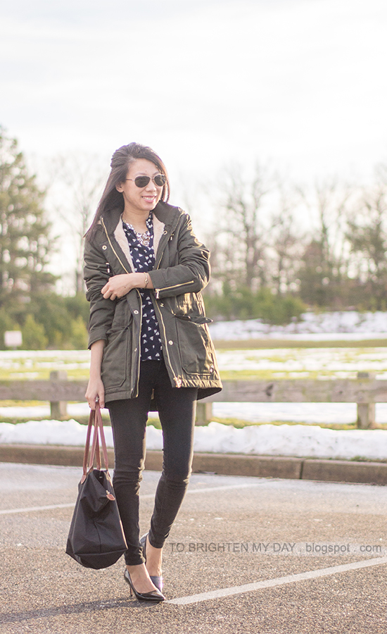 olive green coat, navy printed silk blouse, black jeans, gold jewelry, black patent pumps