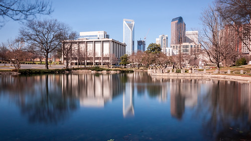 park city longexposure travel blue trees vacation sky sun reflection building tourism nature water beautiful beauty architecture buildings reflections spring pond day bright charlotte sunny bluesky tourist clear uptown cloudless visiting visitor charlottenc clearwater marshallpark noclouds uptowncharlotte