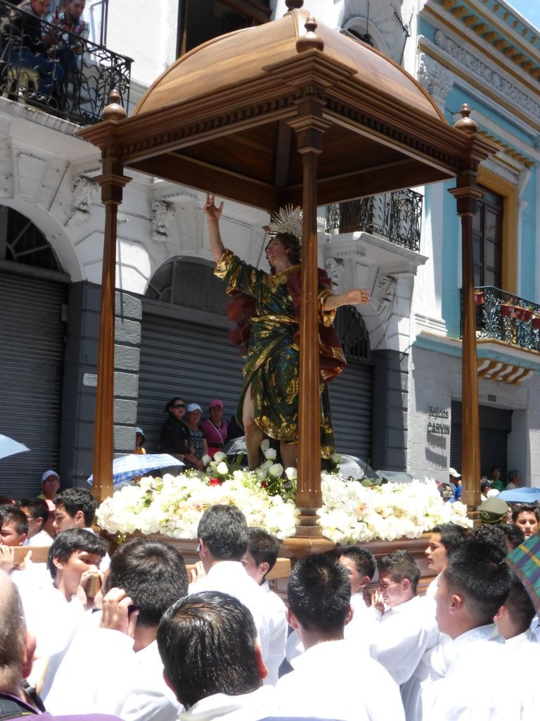 Carved Wooden Jesus statue held aloft at the end of the procession