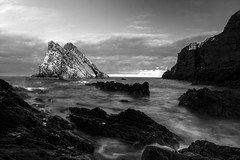 Bow Fiddle Rock, lit up by sunset in long exposure black & white, Portknockie, Moray, Scotland