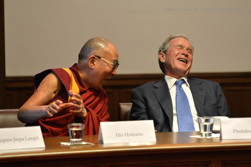 His Holiness the Dalai Lama enjoying a light moment with President Bush