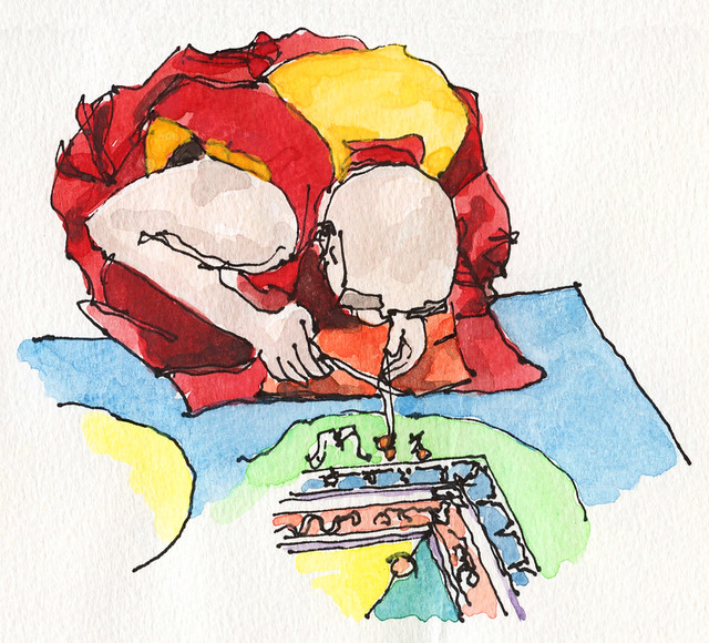 Tibetan monk making a mandala