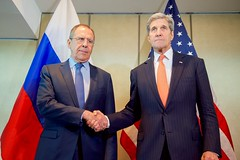 U.S. Secretary of State John Kerry shakes hands with Russian Foreign Minister Sergey Lavrov on February 11, 2016, before a bilateral meeting focused on Syria preceding the Munich Security Conference. [State Department Photo/Public Domain]