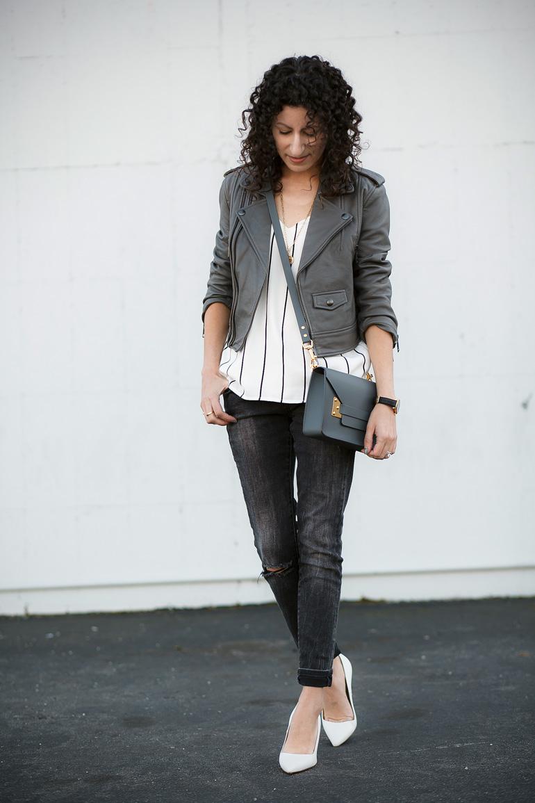 Linea Pelle leather moto jacket, Keepsake pinstripe camisole, Sophie Hulme mini envelope bag