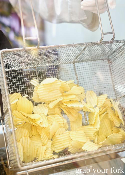 Freshly fried potato crisps at Calbee+ in Harajuku, Tokyo