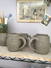 Making textured clay mugs.