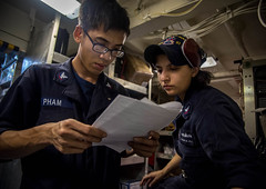 Sailors read instructions while conducting routine maintenance aboard USS Chung-Hoon (DDG 93). (U.S. Navy/MC2 Marcus L. Stanley)