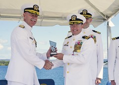 Adm. Scott Swift presents Cmdr. Jeffery Heames the 2015 SECNAV Innovation Award for the innovation leadership category. (U.S. Navy/MC2 Tamara Vaughn)
