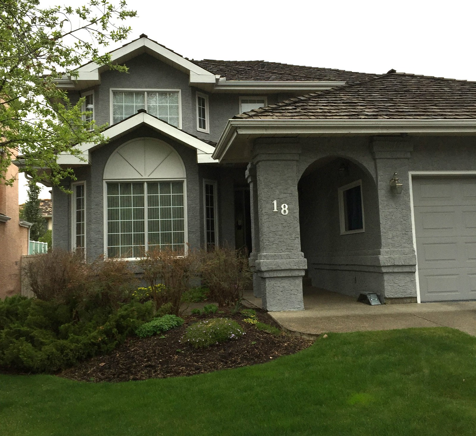 stucco home that has been painted to a modern grey