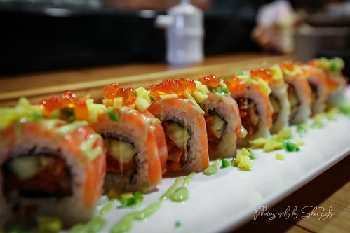 Salmon Twist Roll Spicy Salmon, Pineapple, topped w/Salmon, Wasabi Sauce, Jalapeños, Mango, Salmon Roe - Ogawa