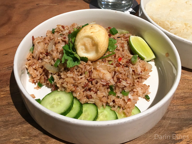Salt Cod Fried Rice Seasoned with namprik relish, soft-boiled egg, green onion, cilantro