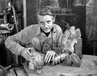 Portrait of sculptor Vernon Voelz in the studio with his works in Sarasota