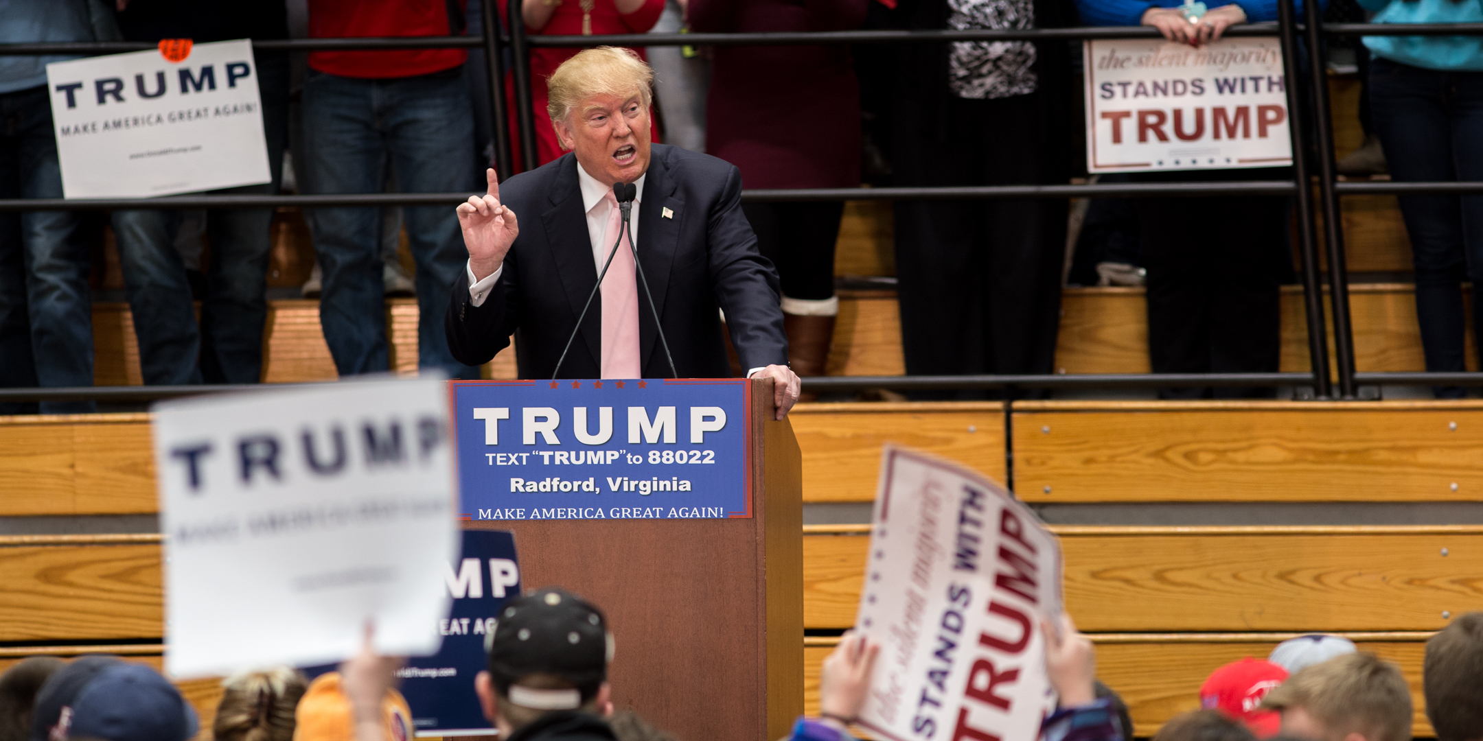 Donald Trump emphatically speaks in front of the crowd.