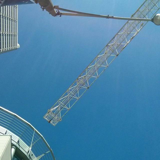 Crane above #toronto #yongeandeglinton #cranes #blue #sky