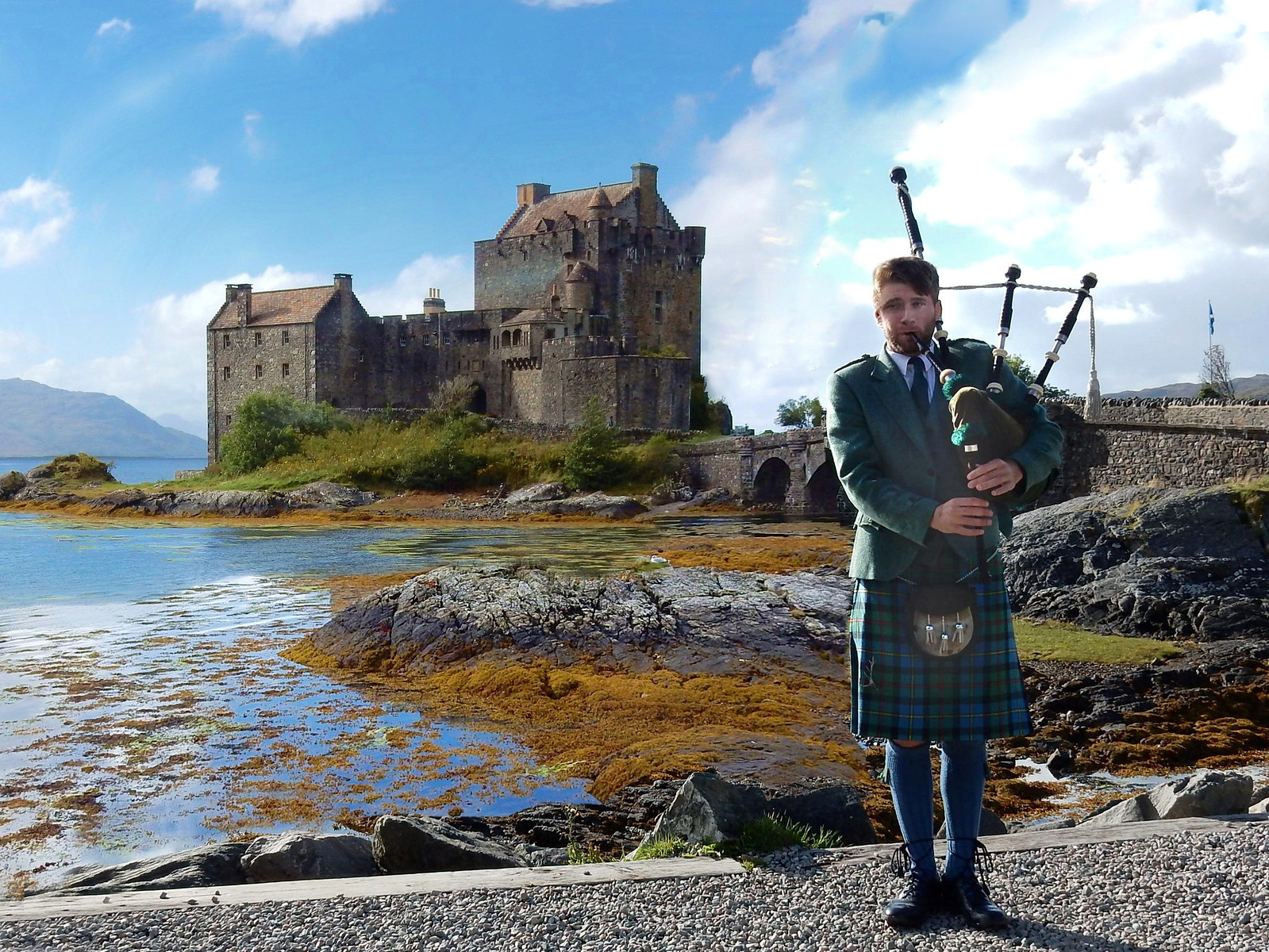 Piper in front of Eilean Donan Castle. Credit Marshalhenrie