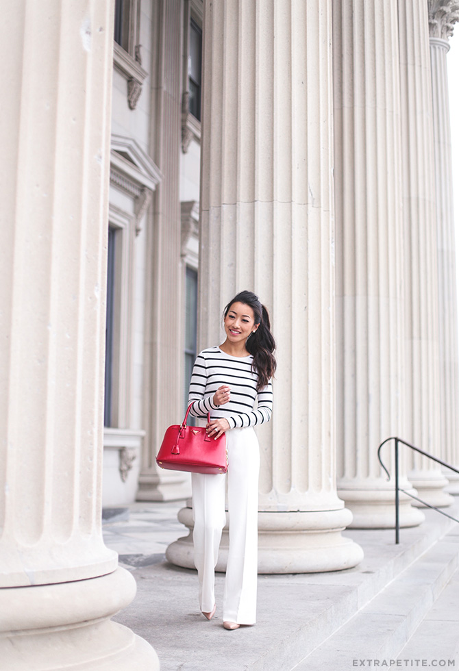 white pants striped tee work outfit red prada bag1