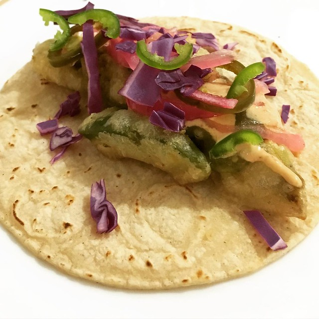 Fried avocado tacos with pickled onions, green salsa, and chipotle cream, all from scratch. I didn't think I could love avocados any more until this moment.