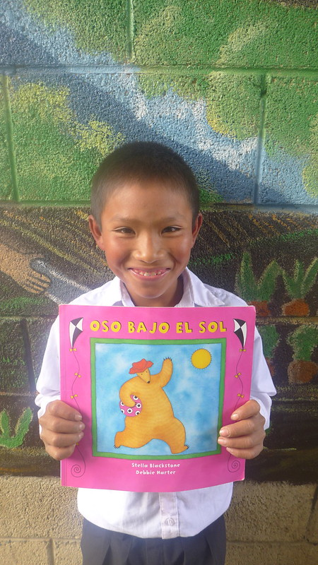 "Florencio with his favorite book, ""Bear Under the Sun"""