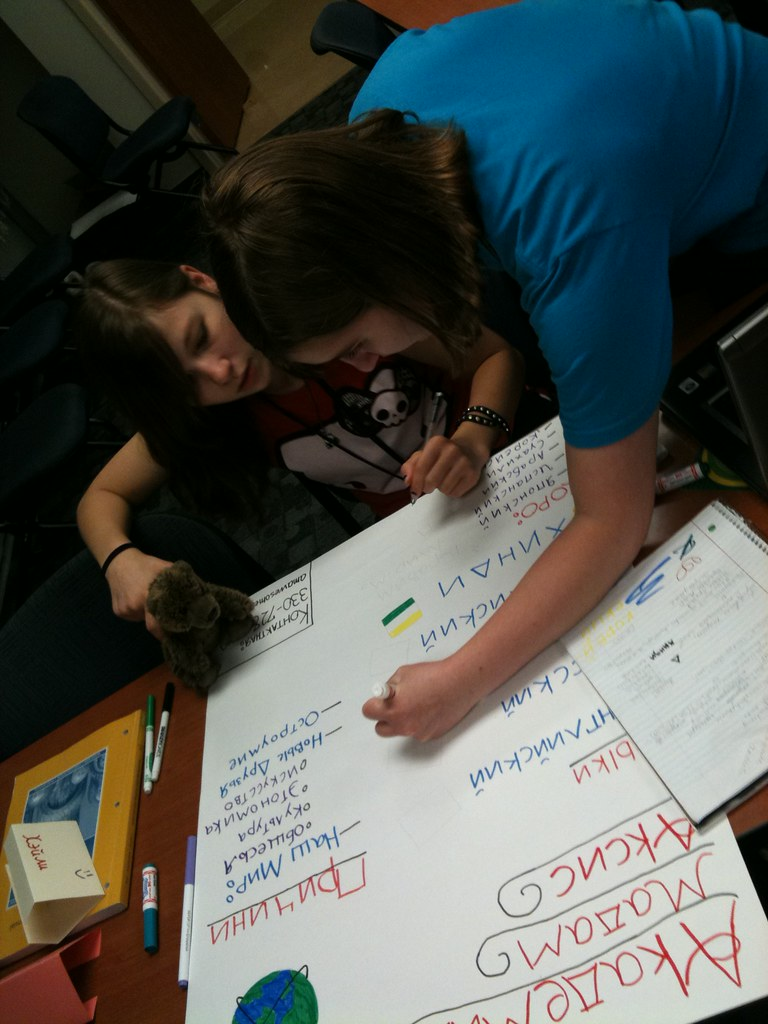 Russian foreign language academy students making a poster.