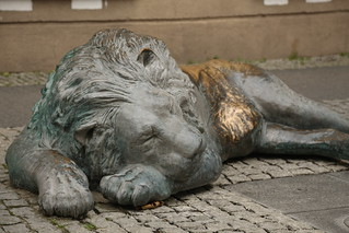 Sleeping bronze lion at Four quarters fountain