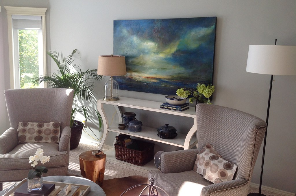 original artwork in living room over white console table and two custom chairs