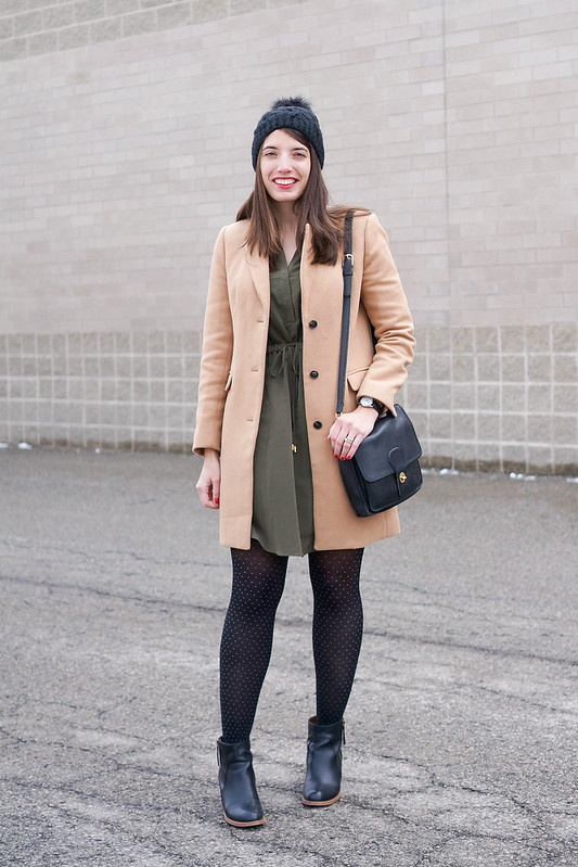 green shirt dress + camel winter coat + polka dot tights + black ankle boots; winter work outfit; Style On Target