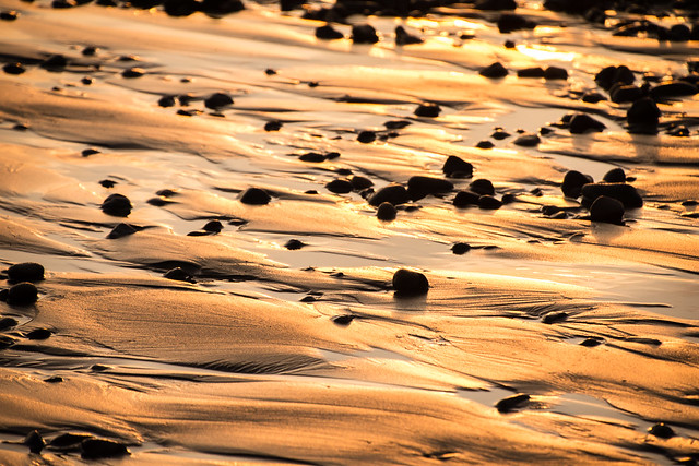 sunset on wet sand
