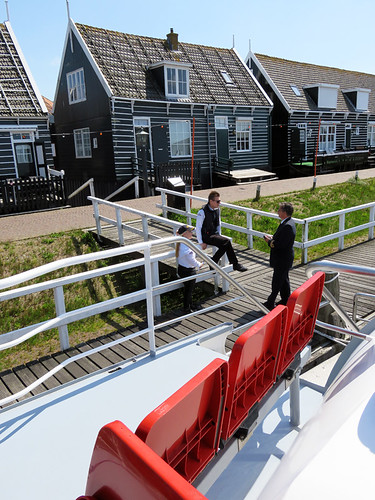 Typical painted wooden houses line the waterfront where the ferry leaves from Marken, Holland